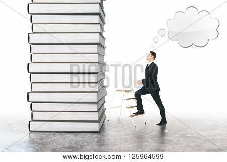 Education concept of businessman with speech bubble climbing book stack