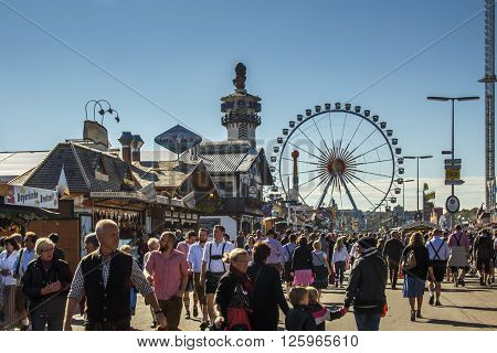 MUNICH, GERMANY - OCTOBER 02, 2015: Main street on Theresienwiese fairground leading to the fun fair area