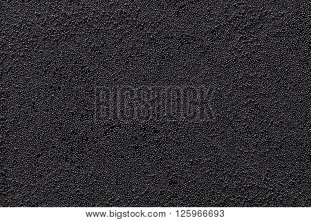 Dark minimalistic abstract background with metal particles. The texture.