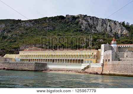 Very old fortress with a lighthouse and hotel in the Arrabida ridge