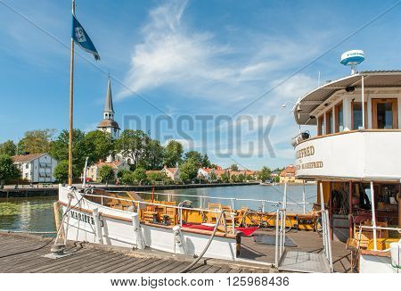 MARIEFRED, SWEDEN - AUGUST 4: Steamship ss Mariefred on August 4, 2011 in Mariefred. This historic in idyllic small town on Lake Mälaren is a popular tourist destination.