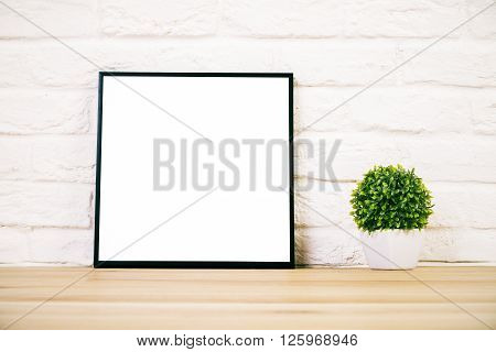 Frame On White Brick