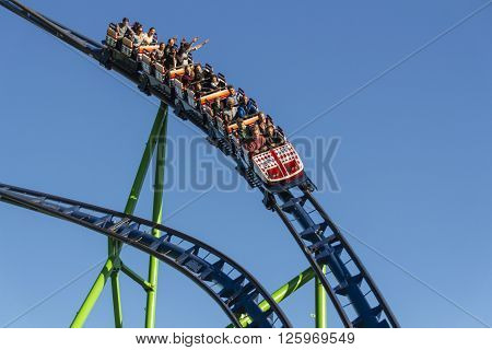 MUNICH, GERMANY - OCTOBER 02, 2015: The Alpinabahn rollercoaster at Oktoberfest is a famous fun ride and attracts many people