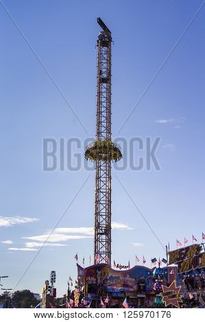 MUNICH, GERMANY - OCTOBER 02, 2015: Free fall tower at Oktoberfest with 80 meter height