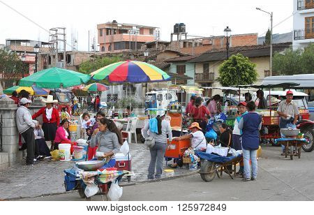 Cajamarca Peru - April 10 2016: Sunday afternoon street scene in the La Recoleta area of Cajamarca Peru with vendors selling food from food carts and wheelbarrows on April 10 2016