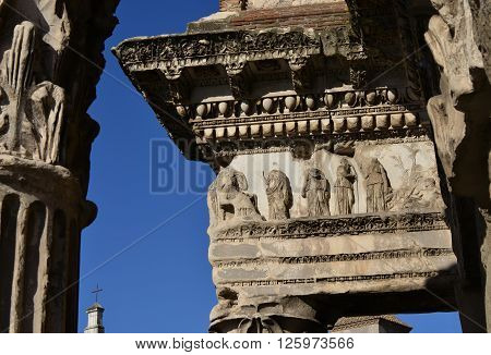 Detail of columns and frieze from ancient Forum of Nerva with scenes of the myth of Arachne