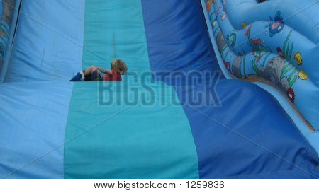 Child Playing On A Slide. Leisure