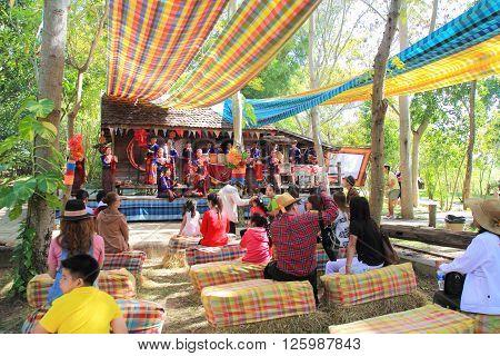 NAKHONRATCHASIMA THAILAND- DECEMBER 14 : Acting folk music in Jim Thompson Farm on DECEMBER 14 2014 in NAKHONRATCHASIMA THAILAND. The House of the world renowned Jim Thompson Thai Silk.