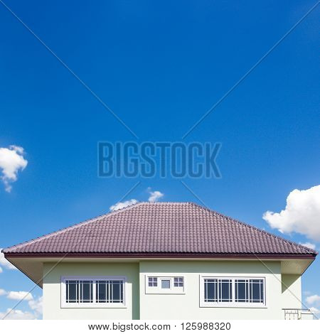 building a new roof of home blue sky as background.