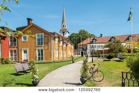 MARIEFRED, SWEDEN - AUGUST 4: Old historic inn Gripsholms Vardshus during summer on August 4, 2011 in Mariefred. This historic idyllic small town on Lake Mälaren is a popular tourist destination