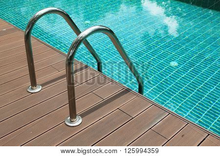Swimming pool with stair in residence, luxury swimming pool.
