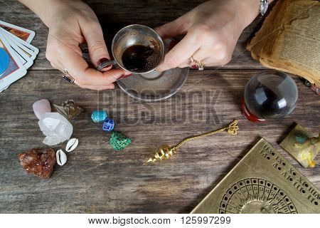 Witch - fortune teller reading fortune from coffee grounds