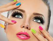 Beauty Girl Portrait with Vivid Makeup and colorful Nail polish. Colourful nails. Fashion Woman portrait close up. Bright Colors. Manicure Make up. Smoky eyes, long eyelashes. Rainbow Colors  poster