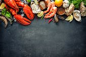 Shellfish plate of crustacean seafood with fresh lobster, mussels, oysters as an ocean gourmet dinner background poster