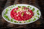 Beetroot and buckwheat risotto with cress Belper Knolle cheese and pine nuts poster