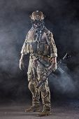 Portrait of US Army Soldier with Four-eyed night vision goggles in the Smoke; Dark and Foggy Background poster