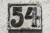 Old retro weathered cast iron plate with number 54 poster