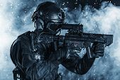Spec ops police officer SWAT in the rain poster