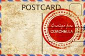 greetings from coachella, stamped on a postcard poster