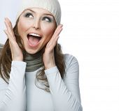 Happy Young Beautiful Woman.Surprised winter Girl over white poster