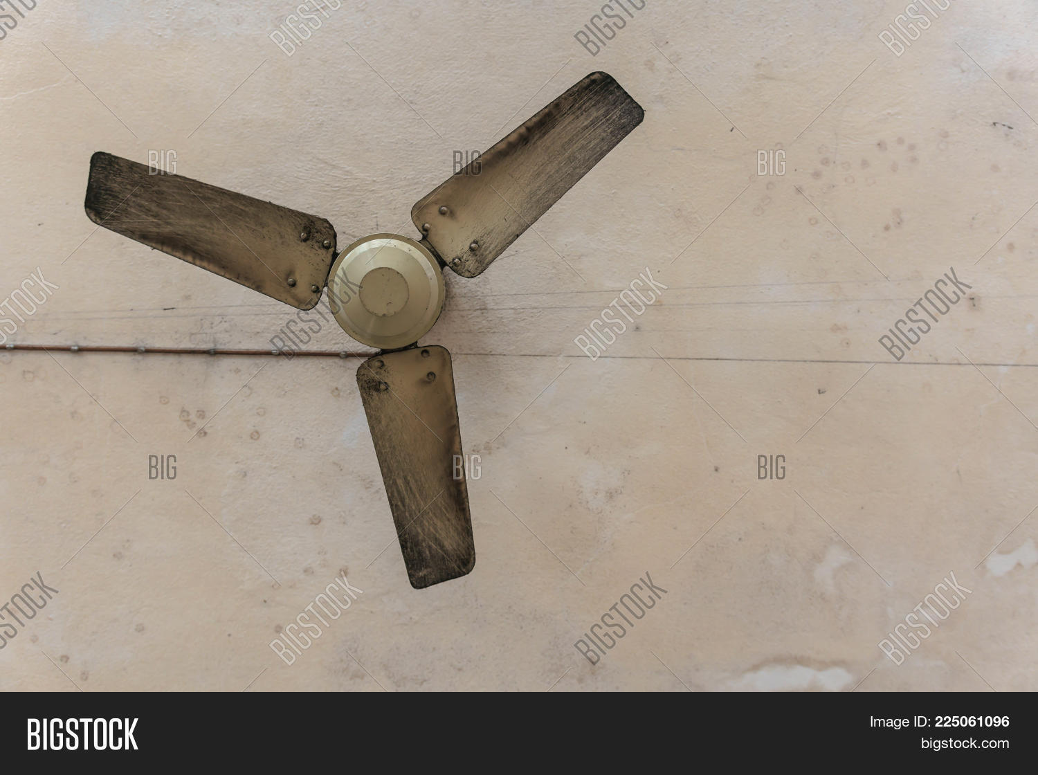 Flat Lay Grunge Old Ceiling Fan With The Old Dirty Ceiling Background.