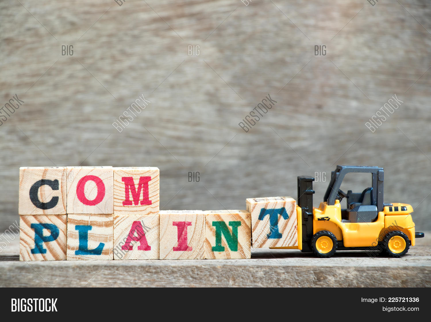 Toy forklift hold letter block t image photo bigstock toy forklift hold letter block t to complete word complaint on wood background spiritdancerdesigns Gallery