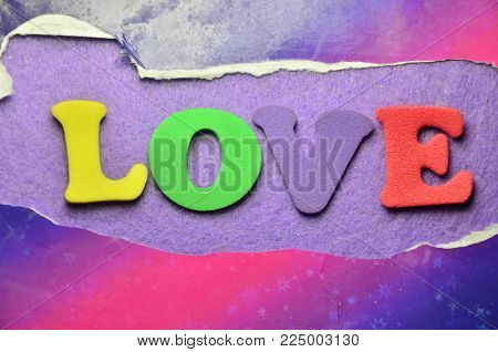 word love on an   abstract colored backgroun d