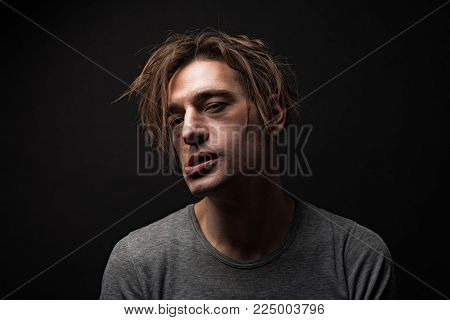 Diseased concept. Portrait of mad drug addicted being on crack. Isolated on background
