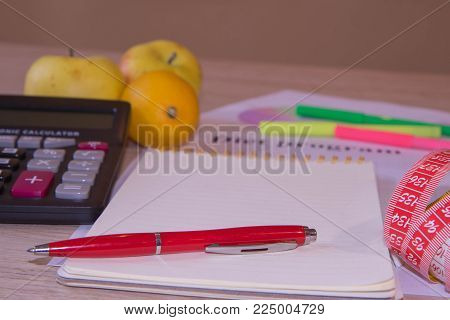 Scale with healthy heart message and measuring tape on table. Weight control concept. Fruit diet. Low-fat diet