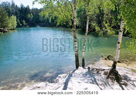 limestone Adrspach rock town and quarry lake - National park of Adrspach - Teplice rocks, East Bohemia, czech republic