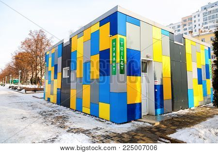 Samara, Russia - February 03, 2018: Vibrant colorful public toilet at the city embankment in winter sunny day. Text in russian: Toilet