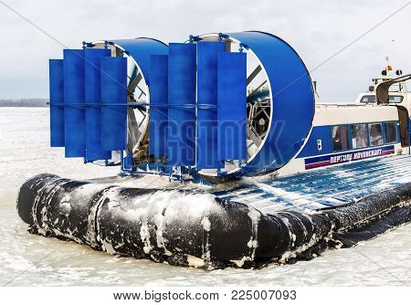 Samara, Russia - February 03, 2018: Passenger hovercraft on the ice of the frozen Volga river in winter day