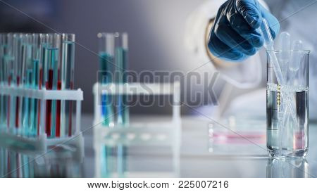 Laboratory assistant putting pipette into sterile mixture after conducting tests, stock video