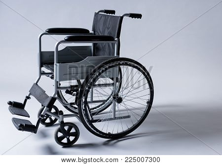Wheelchair for people without the ability moving around. Disability concept. Copy space in right side