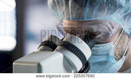 Surgeon performing complicated procedure using modern equipment, healthcare, stock video