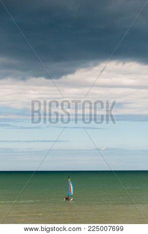 Catamaran  sailing off the coast, Brittany France