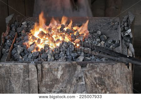 brazier lit in the forge of a blacksmith