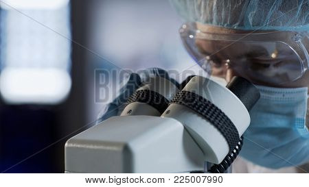 Male scientist in face mask examining biological material, conducting DNA test, stock video