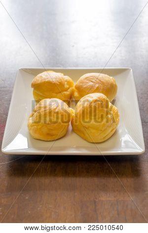 Choux Cream Puffs On White Square Plate