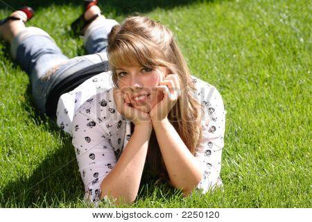 Teenage Girl Laying In The Grass