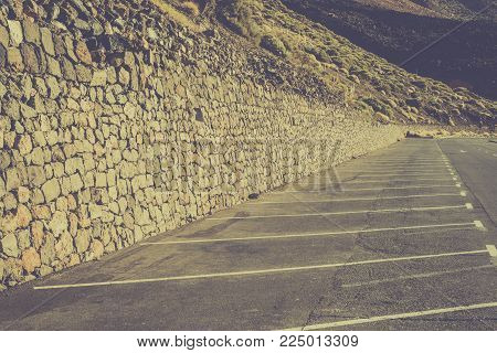 Empty car parking lines in the mountains