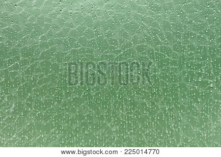 abstract background, droplets on green broken glass