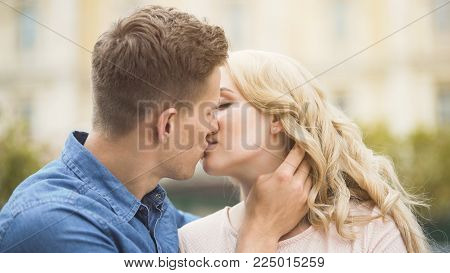 Male and female in love kissing, romantic relationship and dating, close-up, stock video