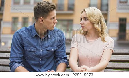 Couple having conflict, looking at each other and talking about problem, crisis, stock video