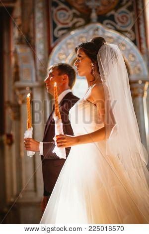 newlyweds wedding ceremony in the church, wedding ceremony, glans.