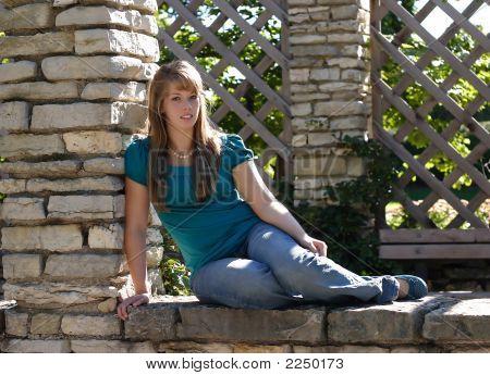 Pretty Girl On A Stone Wall