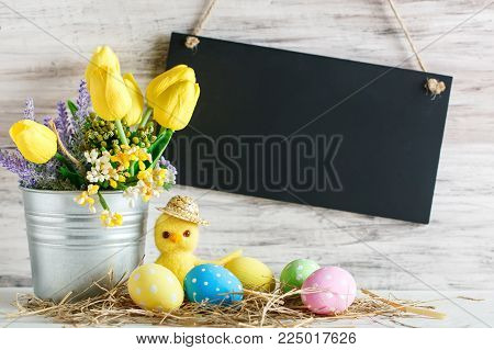 Happy Easter. Congratulatory easter background. Easter eggs and chick. Background with copy space. Selective focus.