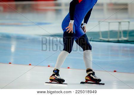feet athlete skater on ice sport arena