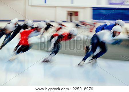 mass start men athletes ice skaters blurred motion