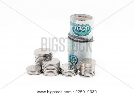 Russian banknotes and coins on a white background